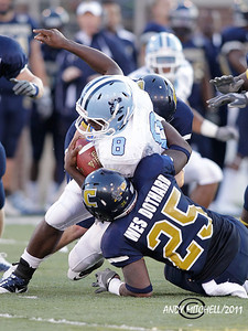 UTC's Wes Dothard(25) make a tackle on Citadel running back Aaron Miller(8). Chattanooga TN 2011