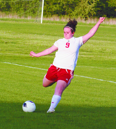 Shayla Robinson goes for a kick in action Thursday evening in Ottumwa.