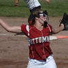 Ottumwa pitcher Brittni Vogt, 11, sends a ball towards the batter in the fourth-inning against Dowling.