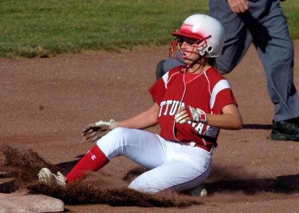 Ottumwa's Olivia Roark, 24, slides safely into second base Tuesday afternoon in action against Iowa City West in the first-inning.