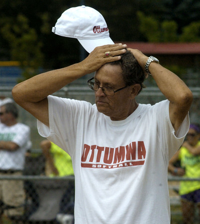 Ottumwa Girls Softball head coach Frank Huston paces Wednesday afternoon as his team plays Marshaltown at the Iowa Girls State Softball Tournament. Second-inning.