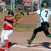 Ball safely in hand, Ottumwa first baseman Nicole Peyton, 27, outs Iowa City West's Tatum Klein in the second inning during the Iowa Girls State Softball Tournament in Fort Dodge.