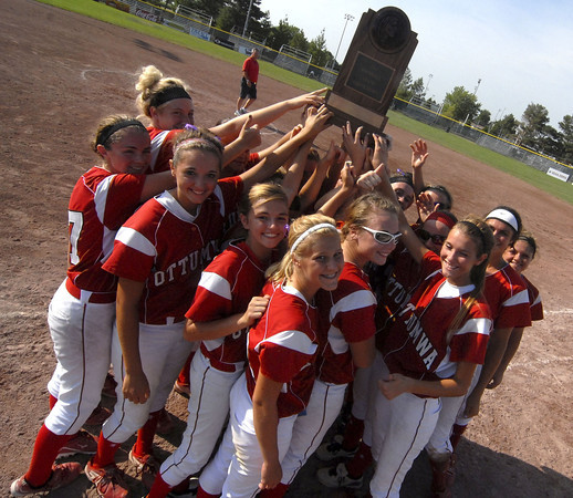 The Ottumwa Bulldogs Girls Softball team holds their trophy up Wednesday afternoon after loosing to Dowling.