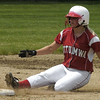 Ottumwa's Sarah Wilson, 19, slides into second base Wednesday morning in softball action against Marshalltown during the third-inning.