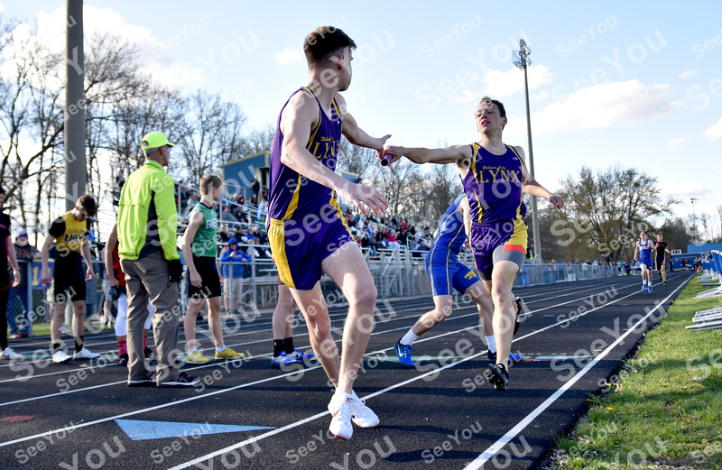 -Messenger photo by Britt Kudla<br /> Webster City Alex Hooker (right) hands the baton to Tucker Judkins in the boys 4x800 relays on Thursday