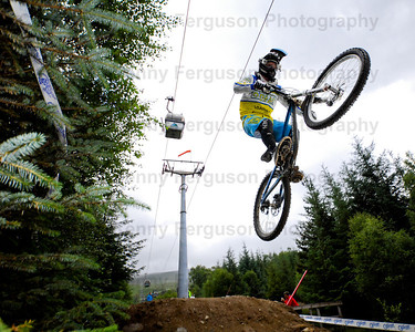 15/07/2012 Competitors tackle the infamous world downhill mountain bike track at Nevis range Fort William Scotland during the Scottish downhill championships.The course runs underneath the gondola and is widely recognisied as one of the best in the world and also one of the longest
