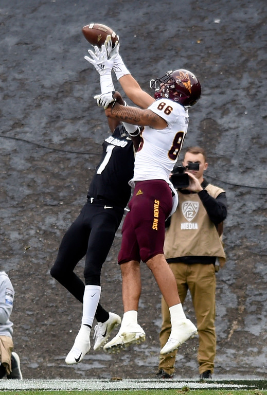 . BOULDER, CO: October 6, 2018: University of Colorado\'s Delrick Abrams Jr knocks the ball from ASU\'s Chris Hodges  during  the game with Arizona State on October 6, 2018. (Photo by Cliff Grassmick/Staff Photographer)