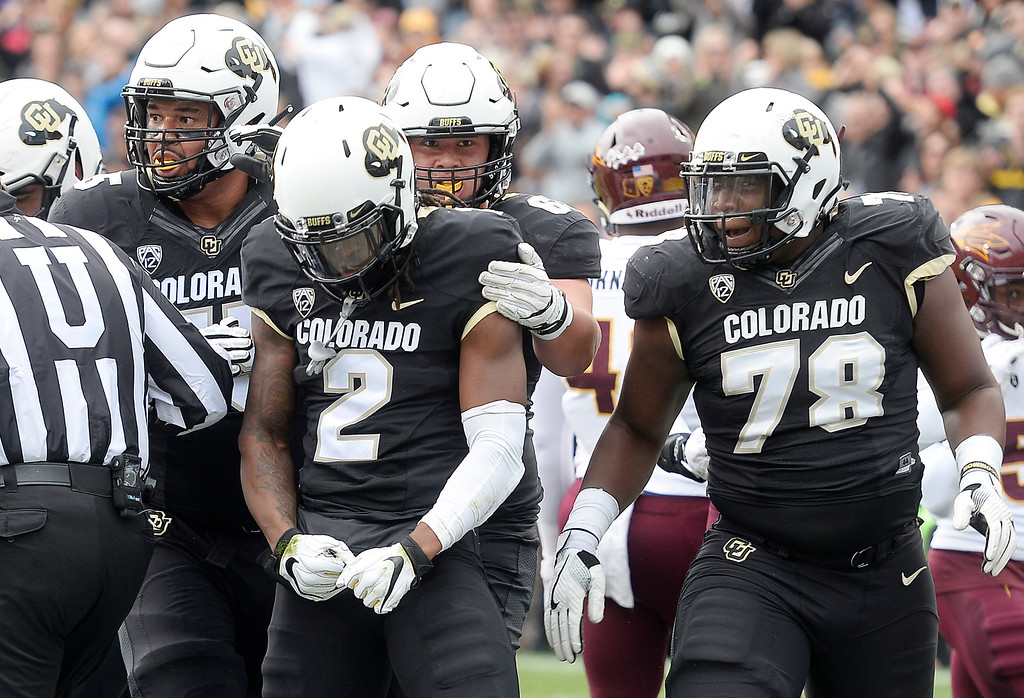. BOULDER, CO: October 6, 2018: University of Colorado\'s  Laviska Shenault is surrounded by his offensive line after his first touchdown during  the game with Arizona State on October 6, 2018. (Photo by Cliff Grassmick/Staff Photographer)