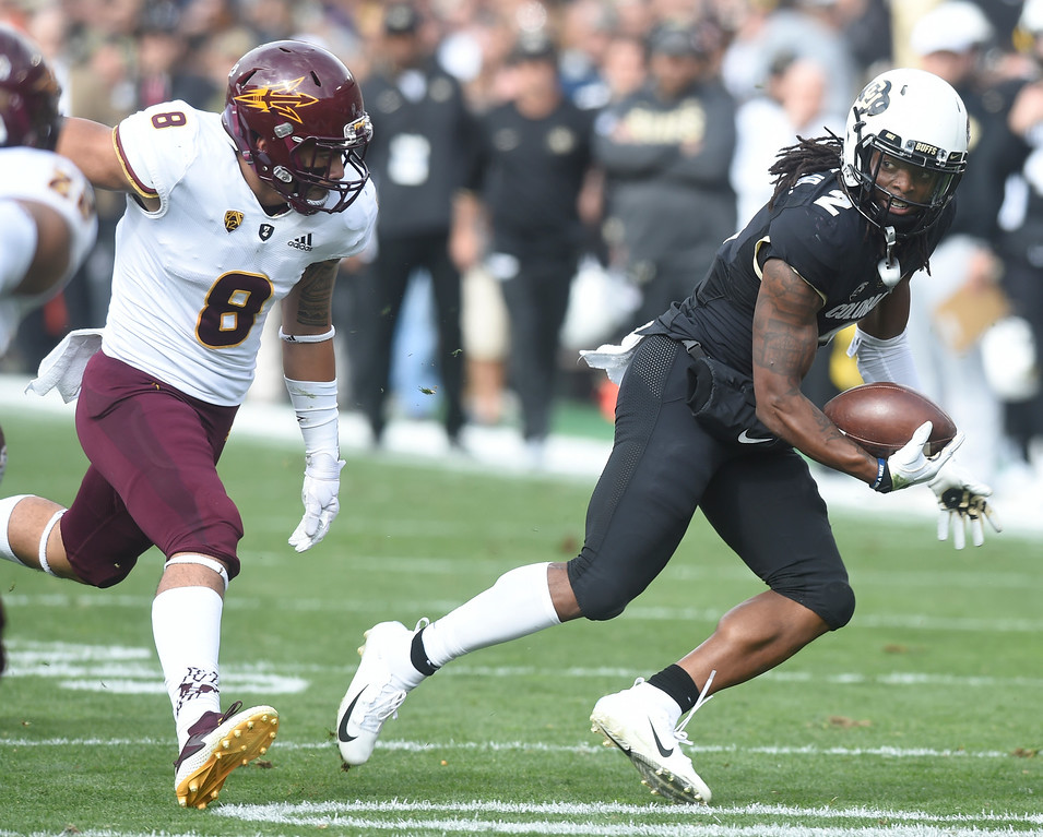 . BOULDER, CO: October 6, 2018: University of Colorado\'s  Laviska Shenault gets around ASU\'s Merlin Robertson during  the game with Arizona State on October 6, 2018. (Photo by Cliff Grassmick/Staff Photographer)