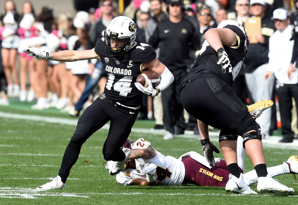 . BOULDER, CO: October 6, 2018: University of Colorado\'s Jay MacIntyre gets past ASU\'s Chase Lucas  during  the game with Arizona State on October 6, 2018. (Photo by Cliff Grassmick/Staff Photographer)