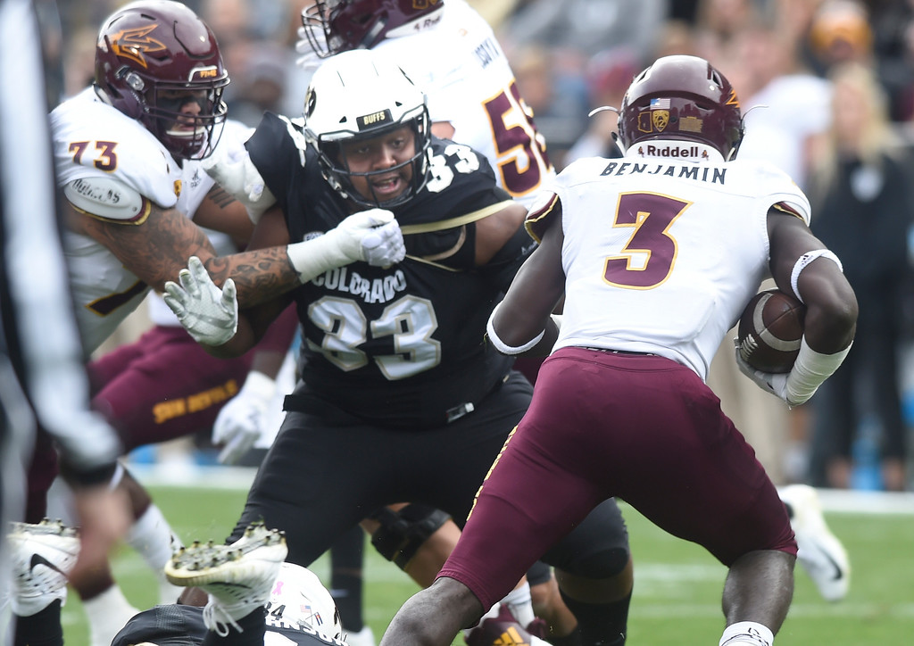 . BOULDER, CO: October 6, 2018: University of Colorado\'s Javier Edwards tries to get ASU\'s Eno Benjamin  during  the game with Arizona State on October 6, 2018. (Photo by Cliff Grassmick/Staff Photographer)