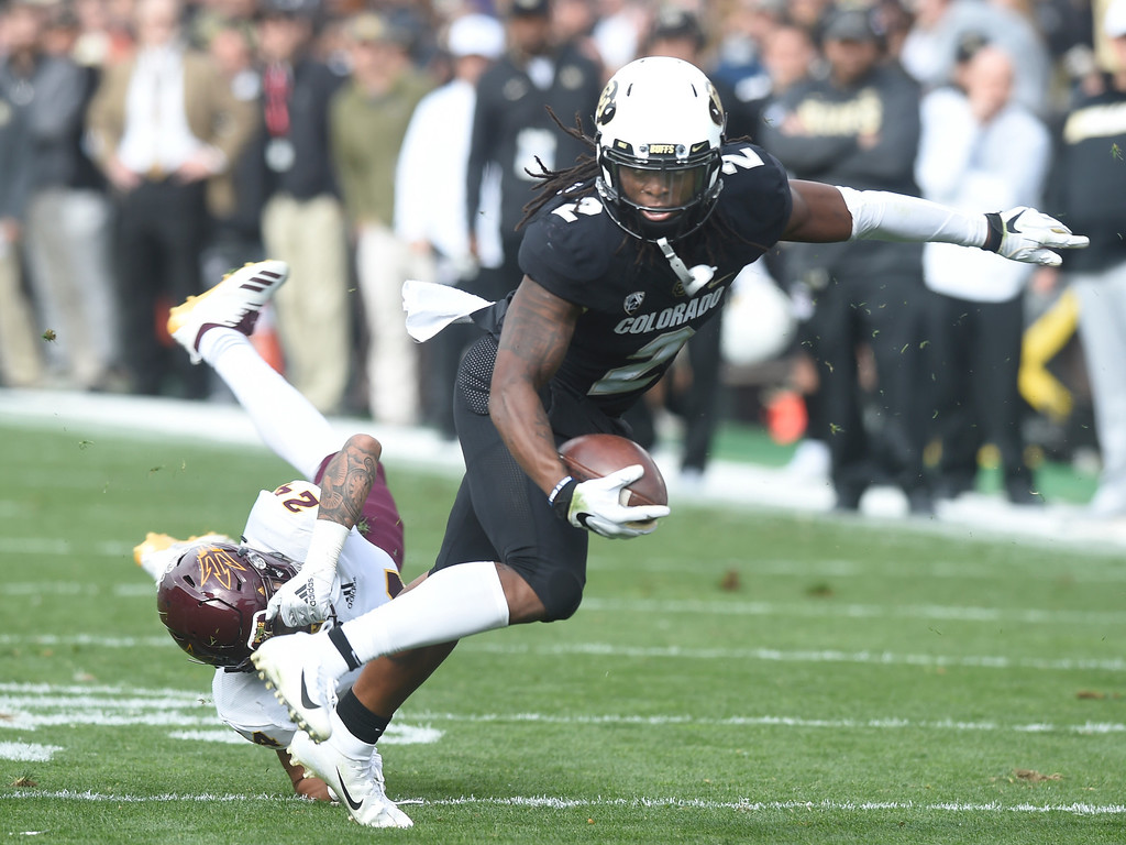 . BOULDER, CO: October 6, 2018: University of Colorado\'s  Laviska Shenault gets around ASU\'s Chase Lucas during  the game with Arizona State on October 6, 2018. (Photo by Cliff Grassmick/Staff Photographer)