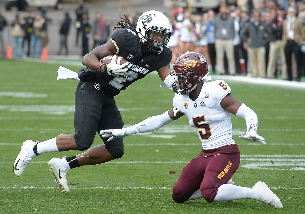 . BOULDER, CO: October 6, 2018: University of Colorado\'s  Laviska Shenault puts a move on ASU\'s Kobe Williams   during  the game with Arizona State on October 6, 2018. (Photo by Cliff Grassmick/Staff Photographer)