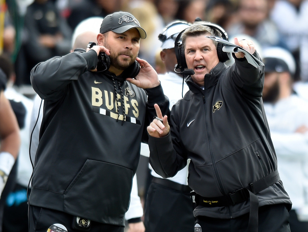 . BOULDER, CO: October 6, 2018: University of Colorado\'s assistant coach, Klayton Adams and head coach, Mike MacIntyre,  during  the game with Arizona State on October 6, 2018. (Photo by Cliff Grassmick/Staff Photographer)