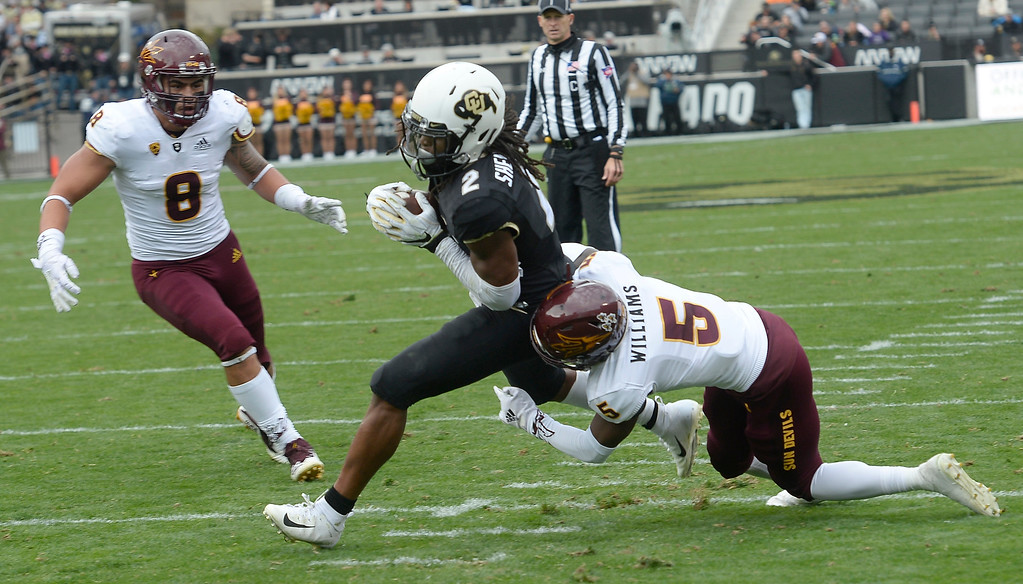 . BOULDER, CO: October 6, 2018: University of Colorado\'s   Laviska Shenault gets away from  ASU\'s Kobe Williams  for his second touchdown during  the game with Arizona State on October 6, 2018. (Photo by Cliff Grassmick/Staff Photographer)