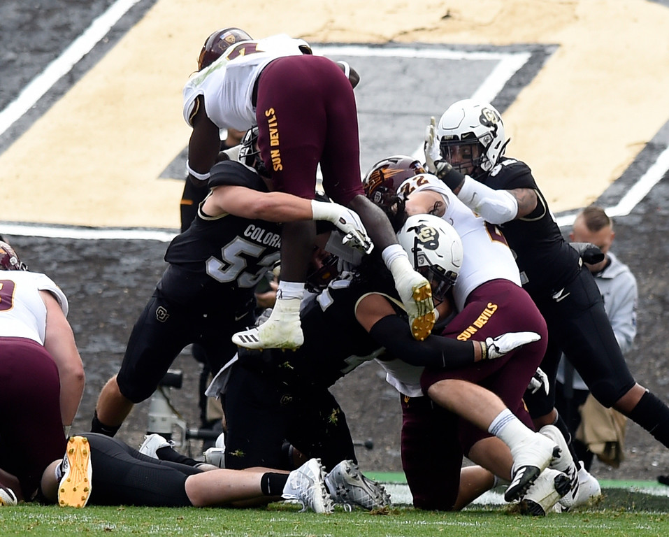 . BOULDER, CO: October 6, 2018: University of Colorado\'s Nate Landman tries to stop ASU\'s Eno Benjamin from scoring  during  the game with Arizona State on October 6, 2018. (Photo by Cliff Grassmick/Staff Photographer)