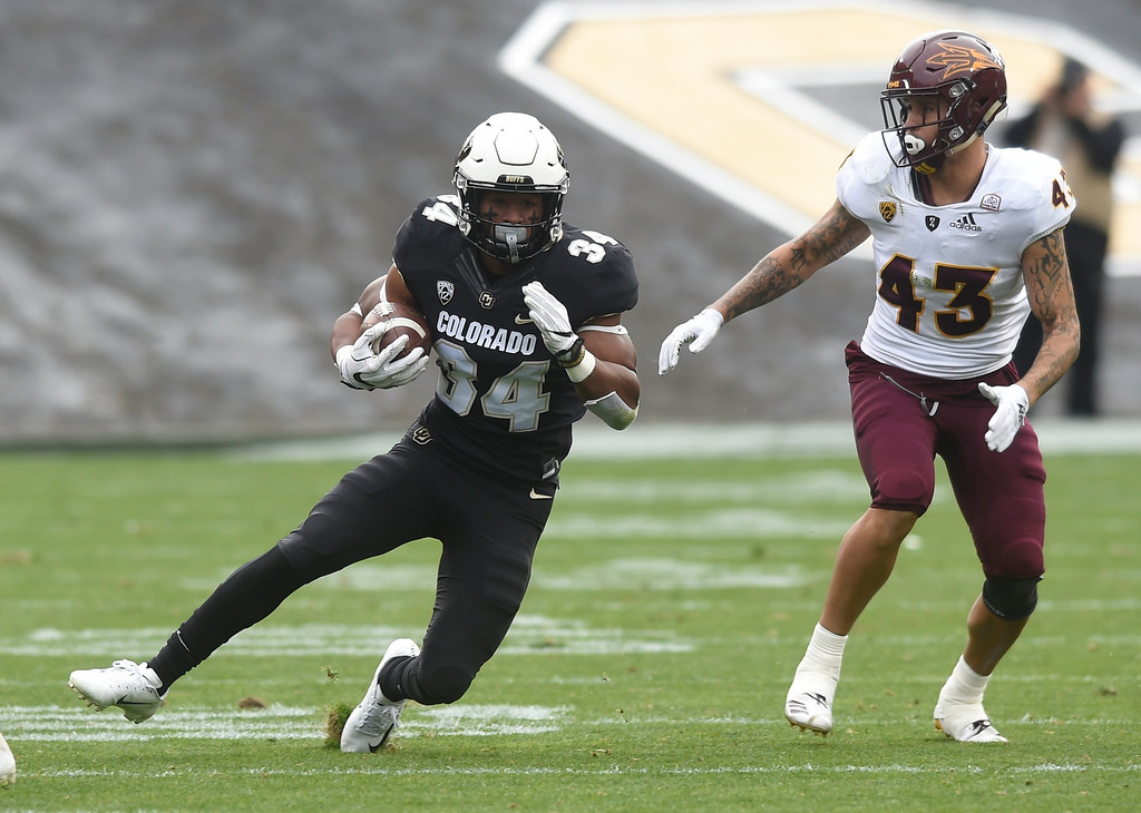 . BOULDER, CO: October 6, 2018: University of Colorado\'s Travon McMillian gets past ASU\'s Jalen Harvey  during  the game with Arizona State on October 6, 2018. (Photo by Cliff Grassmick/Staff Photographer)