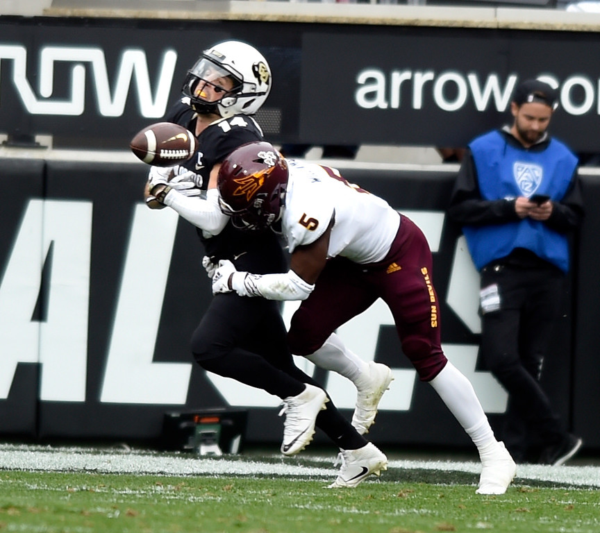 . BOULDER, CO: October 6, 2018: University of Colorado\'s  Jay MacIntyre gets the ball knocks away by ASU\'s Kobe Williams  during  the game with Arizona State on October 6, 2018. (Photo by Cliff Grassmick/Staff Photographer)