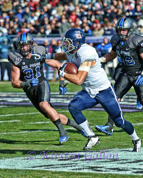Rice QB #16 Taylor McHargue trying to get arounf the corner for some more yardage. Air Force DB #31 Brian Lindsay is in pursuit.