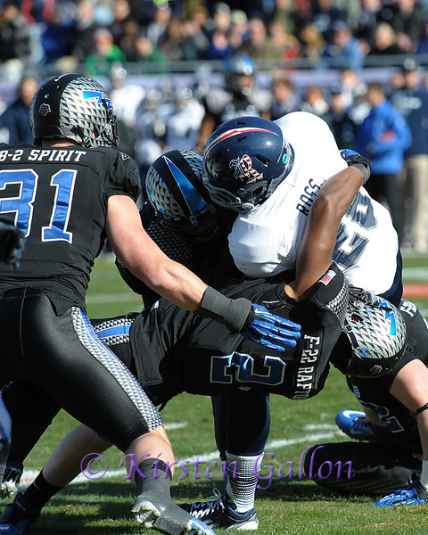 Air Force linebacker #2 Stephen Altrice puts a stop on Rice running back #28 Charles Ross.