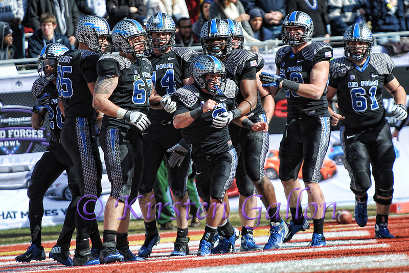 Air Force O-line greets QB #2 Kale Pearson after he scores on a short run.