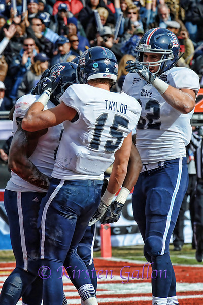 Rice players #15 Jordan Taylor and #82 Luke Wilson congratulate #28 Charles Ross on his touchdown score.