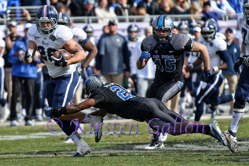 Rice RB #26 Turner Peterson slips through Air Force DB #23 Steffon Batts arms. #45 LB James Chambers is in pursuit.