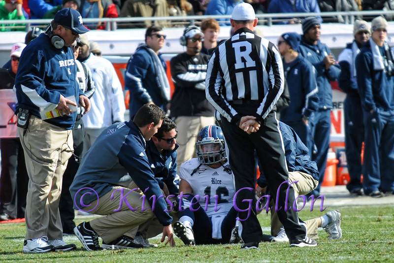 Team trainers evaluate Rice QB Taylor McHargue after a hit that took him out of the game.