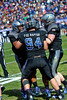 The Air Force defense celebrates a fumble recovery.