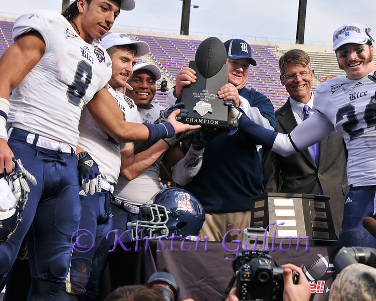 Head Coach David Bailiff and several Rice players with the Bell Helicopter Bowl trophy.