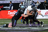 Air Force LB #42 Niklas has a hold on a Rice RB #26 Turner Peterson.