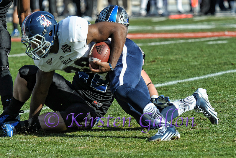 Rice RB #28 Charles Ross tries to keep his balance, but a knee just touches the ground.