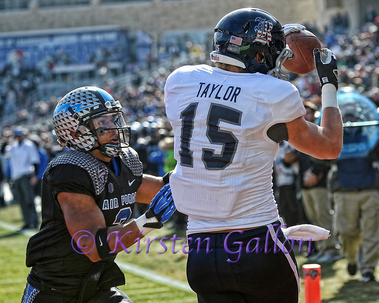 Air Force DB #3 Chris Miller can only look on as Rice receiver #15 Jordan Taylor catches the pass for a touchdown.