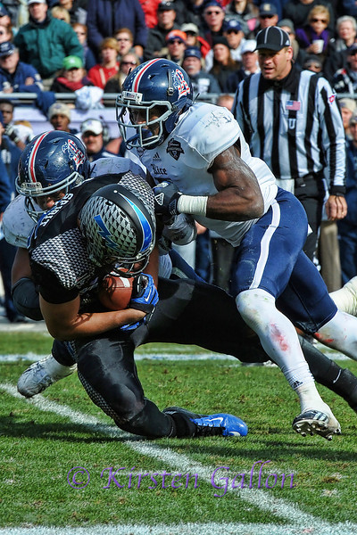 Rice defense takes down Air Force running back.