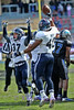 Rice defensive end #40 Zach Pratt and corner #37 Drew Travis celebrate Pratt's fumble recovery on Air Force's last drive to clench the game.