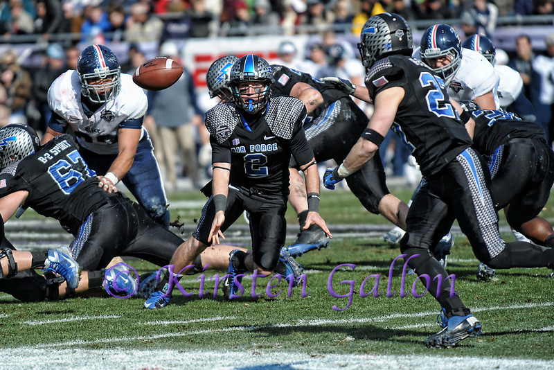 The ball hangs in the air after Air Force QB #2 Kale Pearson pitches it to #27 WR Ty MacArthur.