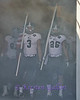 Rice players #3 Taylor Cook and #26 Turner Peterson lead the team down the tunnel
