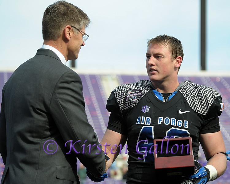 John Garrison of Bell Helicopter and Falcons player of the game, Air Force linebacker #42, Austin Niklas