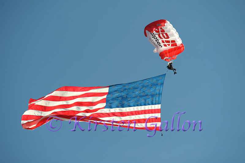 Dana Bowman, a double amputee, brings in a 1,500 sq. ft.  American Flag to the Bell Helicopter Armed Forces Bowl Game.