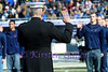 Marine General Whistler officially swears in new recruits during halftime.