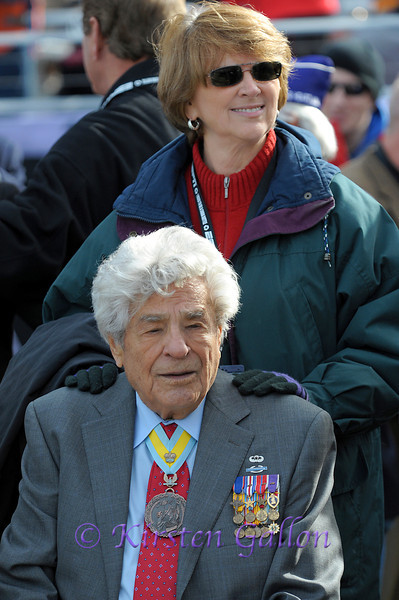 "Lt. Colonel (Ret.) James ""Maggie"" Magellas, the most decorated soldier of WWII's 82nd Airborne.  Standing behind Lt. Col. Magellas is Toni Russell of American Airlines."