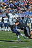 Rice QB #6 Driphus Jackson gets the ball away just before being tackled.