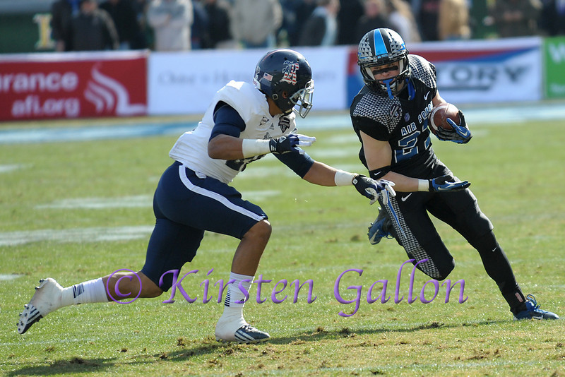 Air Force Receiver #22 Christian Gann looks to elude Rice CB #22 Ryan Pollard.