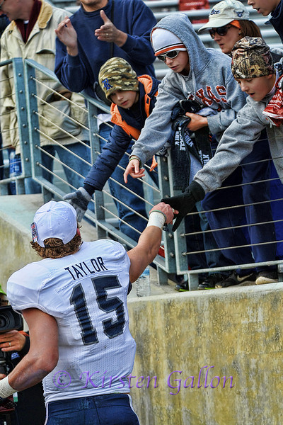 #15 Jordan Taylor takes time to shake a few fan's hands as he heads off the field as the Armed Forces Bowl MVP.