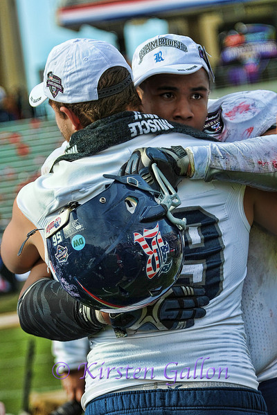 Rice players with a congratulatory hug after the win.