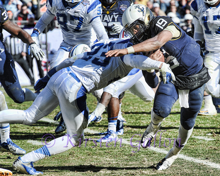 Armed Forces Bowl 2014<br /> Safety Chris Brown puts a stop to QB Keenan Reynolds forward progress.