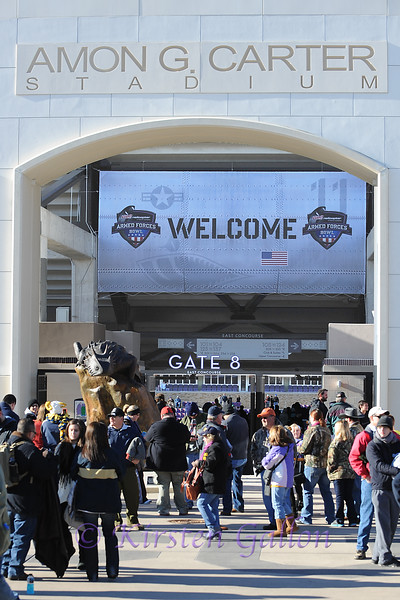 Fans outside Amon Carter stadium as they arrive for the game.