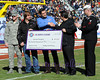 Armed Forces Bowl 2014<br /> Viktor Zikas from Operation Homefront accepts a check for $300,000 from respresentatives of the Murphy-Goode Winery out of Northern California.