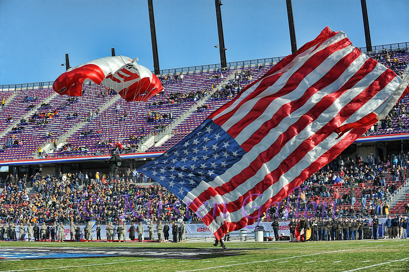 Armed Forces Bowl 2014<br /> A paratrooper carrying the US Flag makes his way into the staduim with a safe landing.