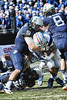 LB James Britton puts a stop to FB Corey Carmichael.